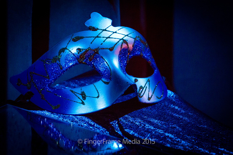 Image of a mask in dramatic blue light